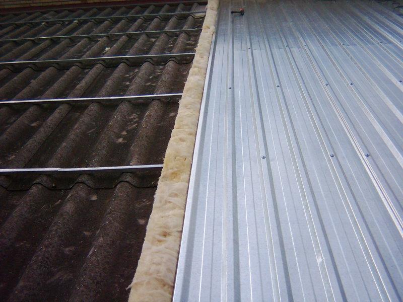 Doblado de cubierta sobre tejado de uralita en Taim WESER Zaragoza